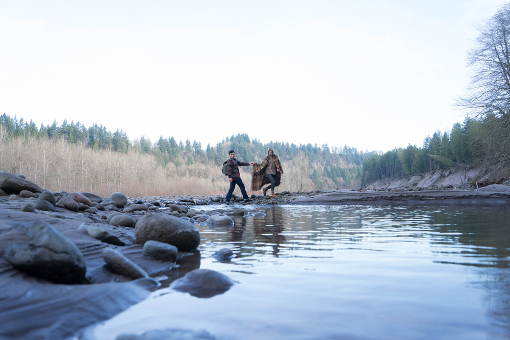 Two hikers near the river