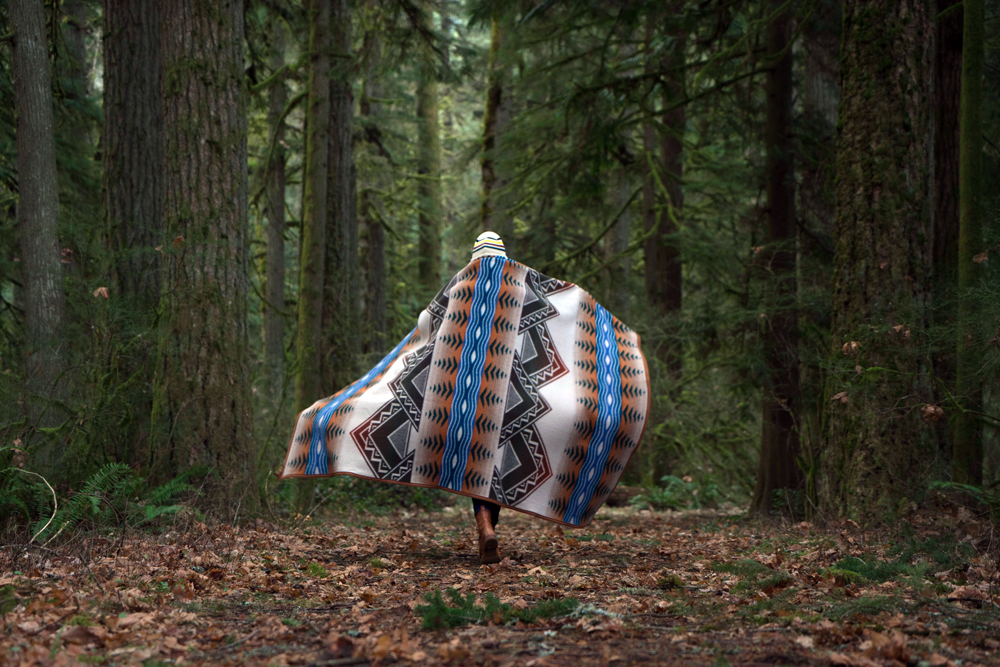 A woman wears an America's Treasure Pendleton blanket over her shoulders