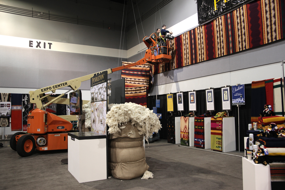 Workers attach the world's longest wool blanket to a wall