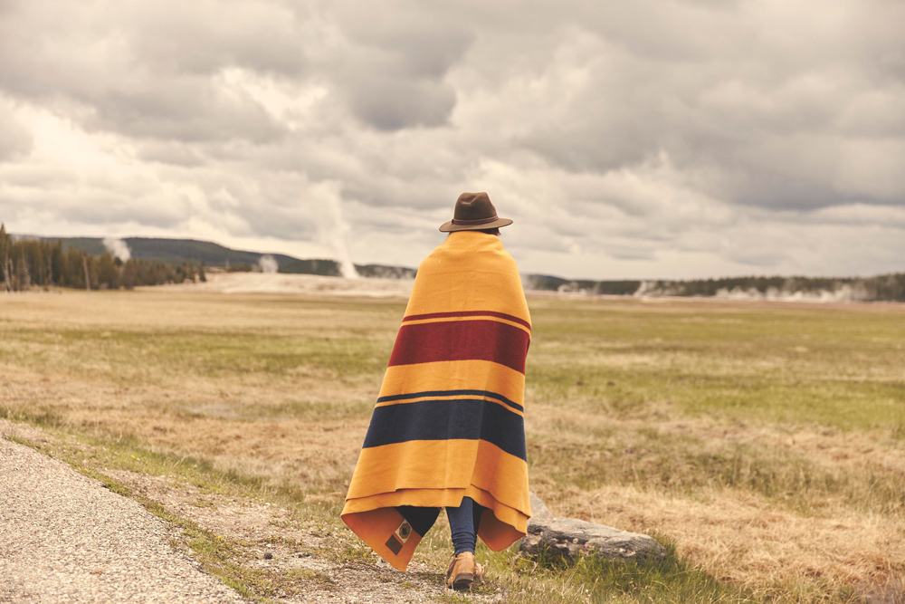 OurFreeWays_ A woman wrapped in a Pendleton Yellowstone Park blanket