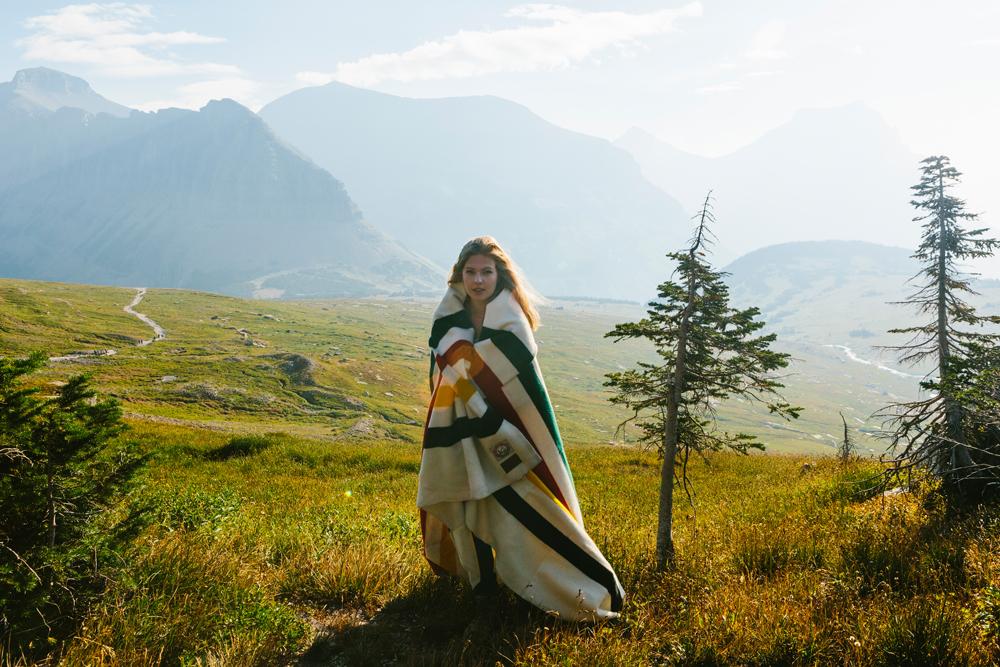 Irey_A woman wrapped in a Glacier blanket at Glacier Park