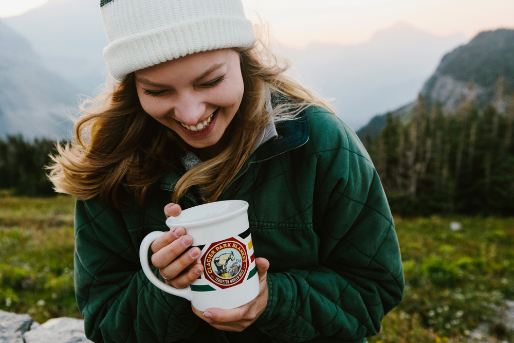 Irey_A woman wearing a knitted cap and holding a coffee cup