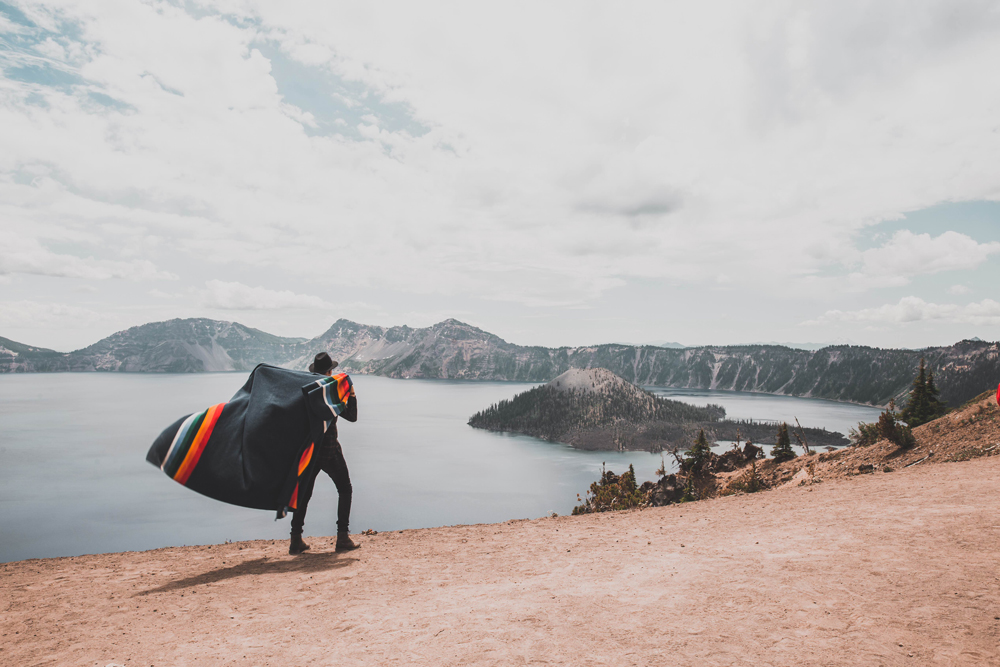 Kyle Houck - A man with a Crater Lake blanket slung over his shoulders walks near Oregon's Crater lake.