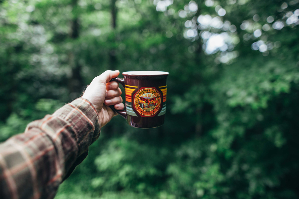 Matthews_ A hand holding out a Great Smoky coffee cup