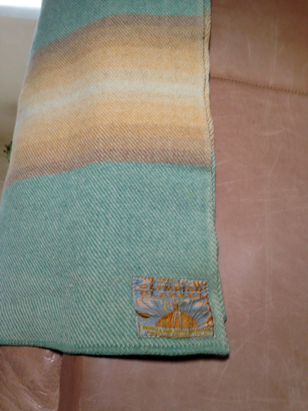 A beautiful Pendleton Olympiad blanket in teal, with a twill weave and an embroidered label.