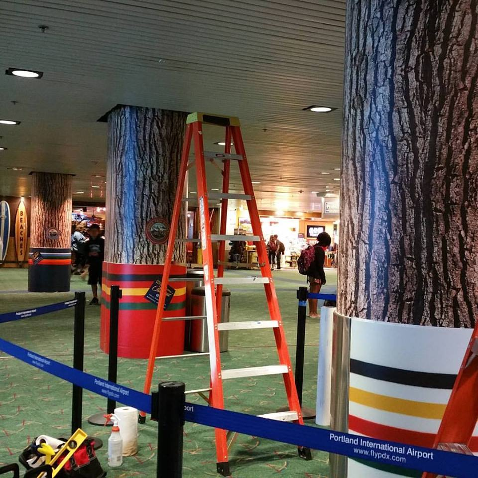 PDXForest - columns wrapped with Park Stripes and bark