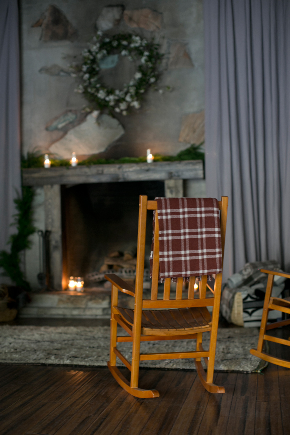 rocker with a Pendleton throw by the fireplace