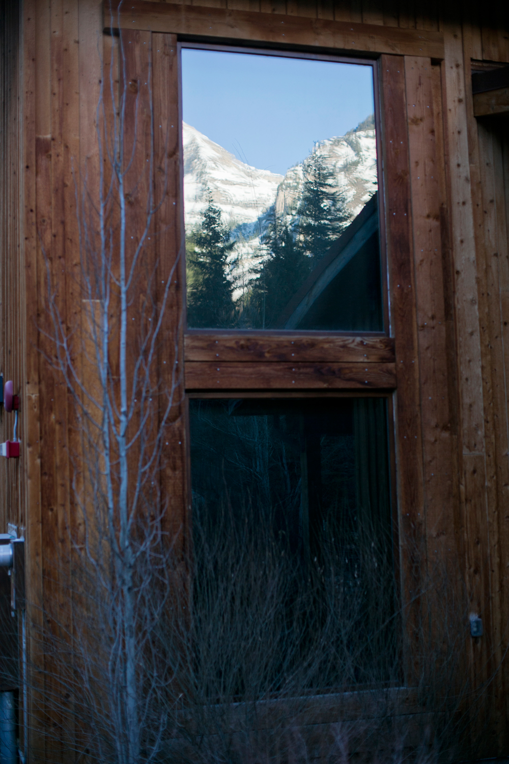 The mountains reflected in a window