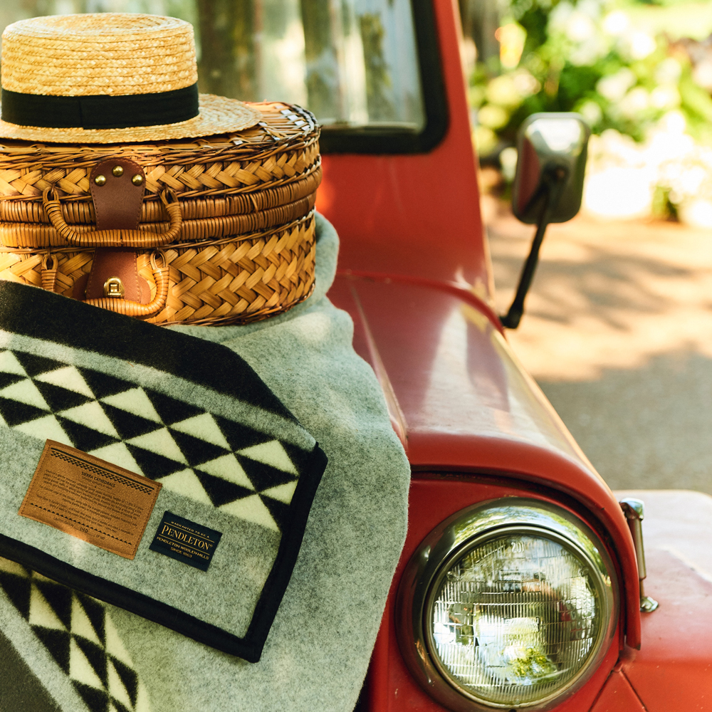 Taylor_Colson_Horton_Cameron_Powell shot of a red vehicle, blanket and basket.