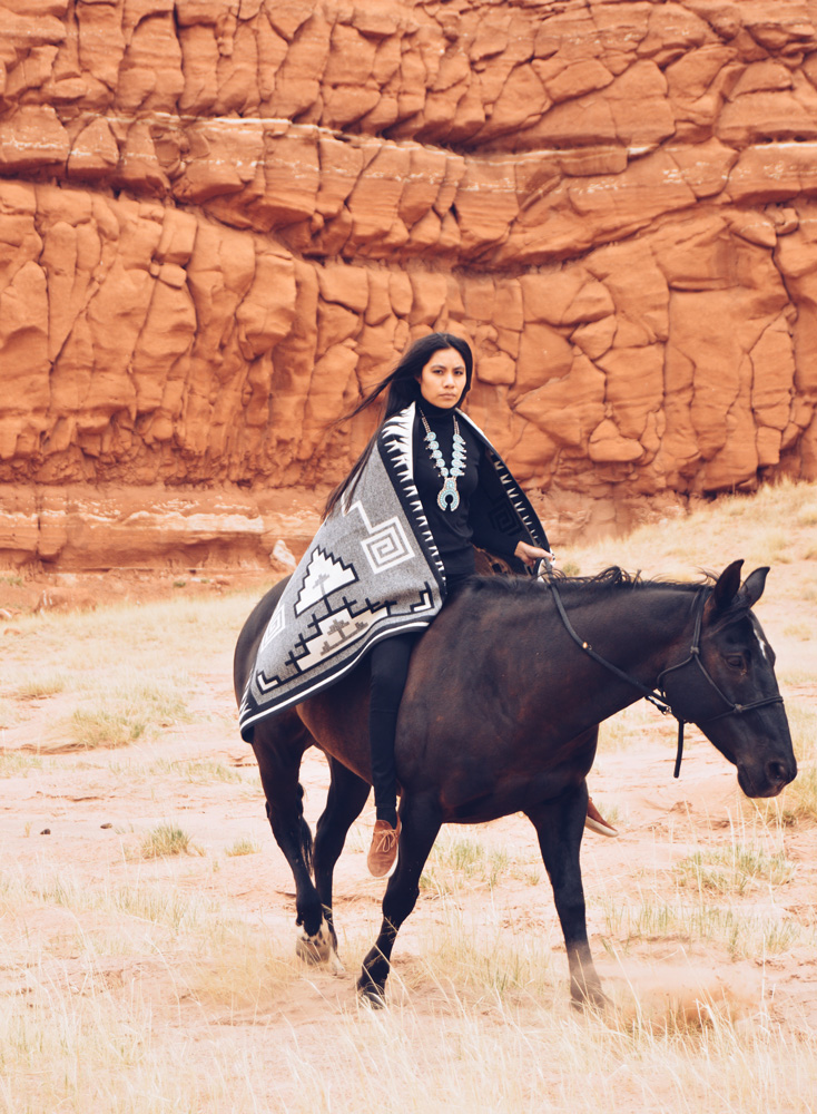 Shondina Lee Yikasbaa with Naskan saddle blanket - posed on horseback