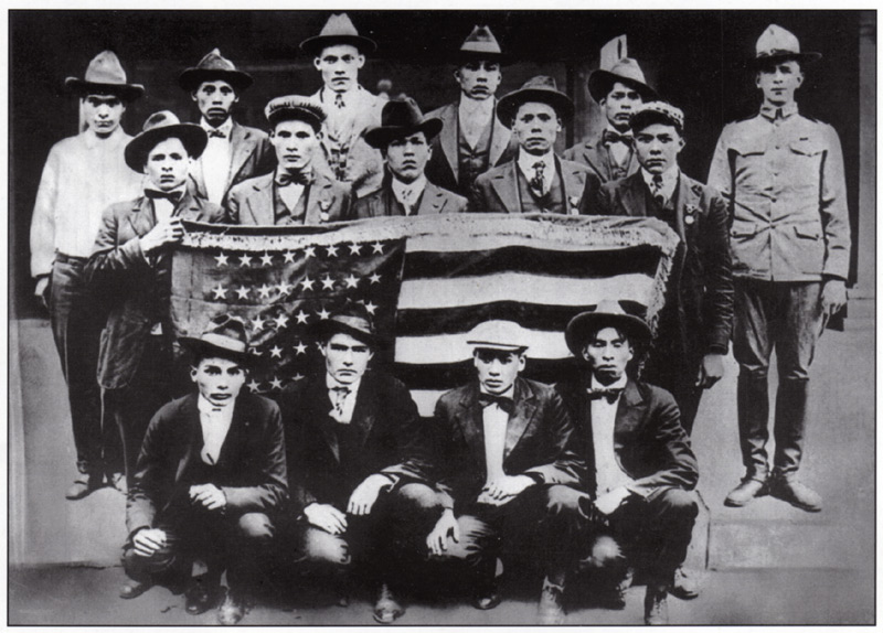 Choctaw coders pose with American flag