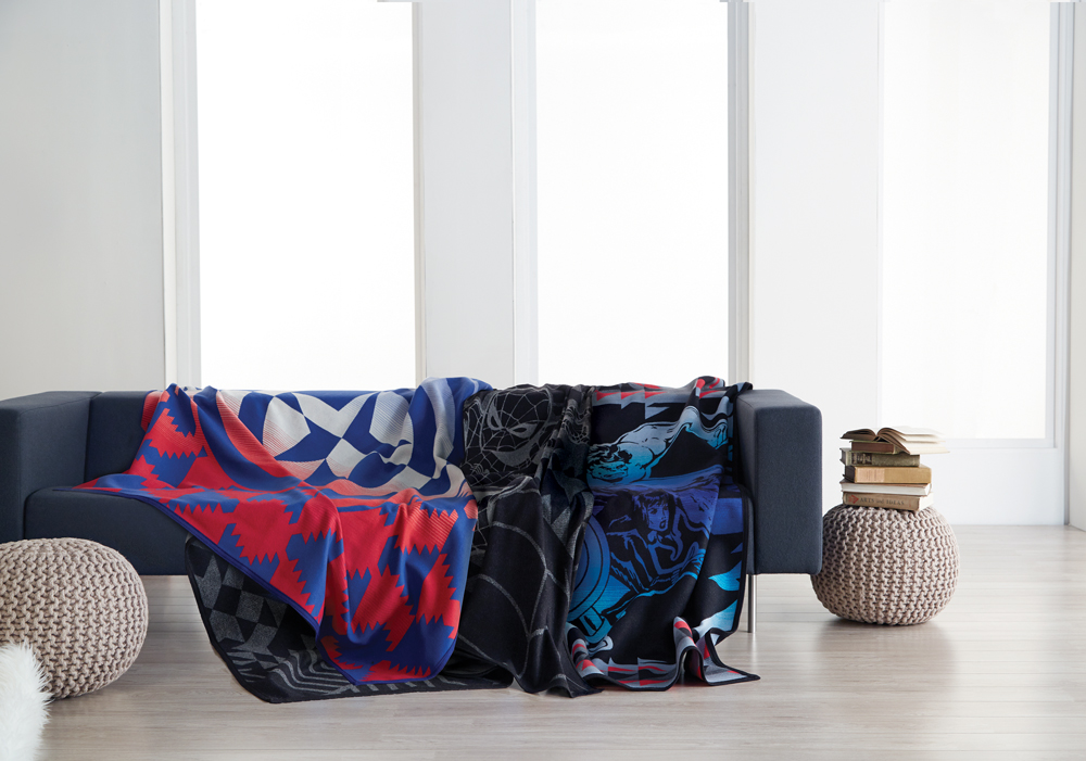 The aMarvel blankets on a sofa.