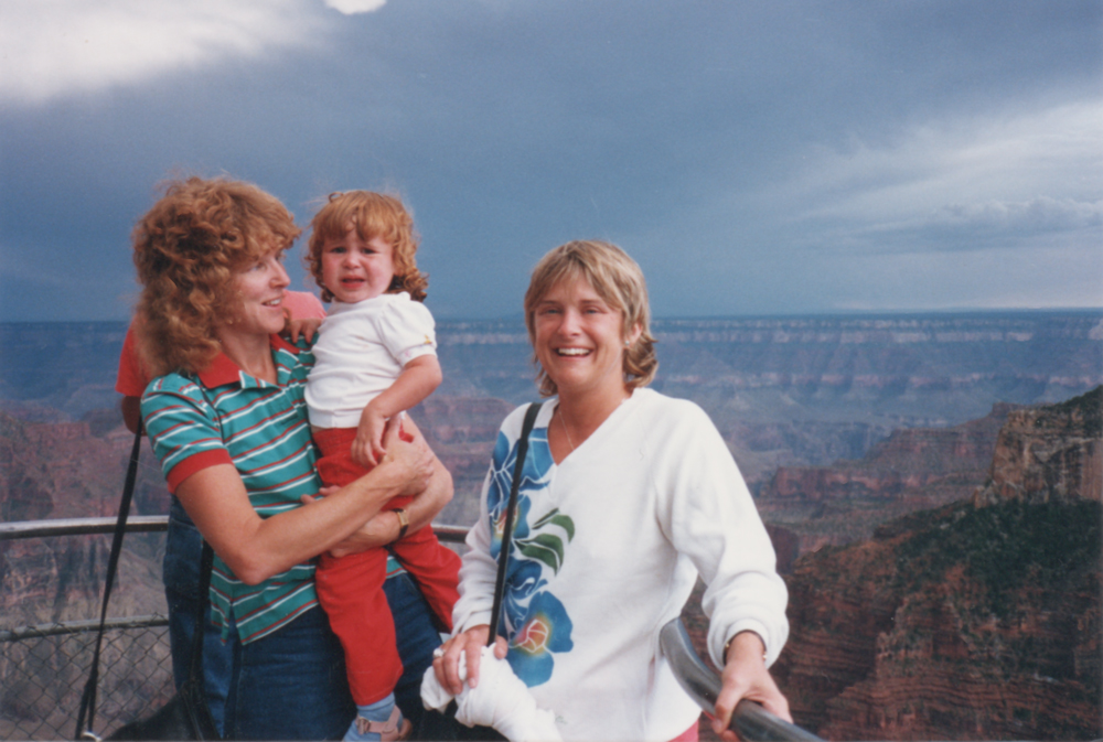 A 1980s photo of two women and a crying toddler at the Grand Canyon