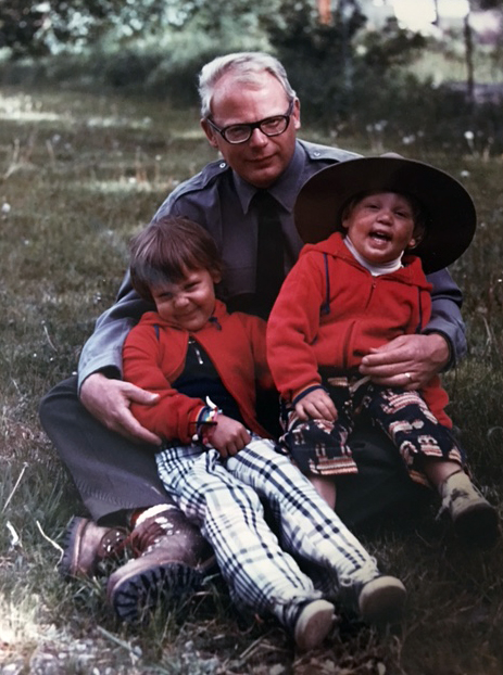 A photo of a father and two children from the 1970s.