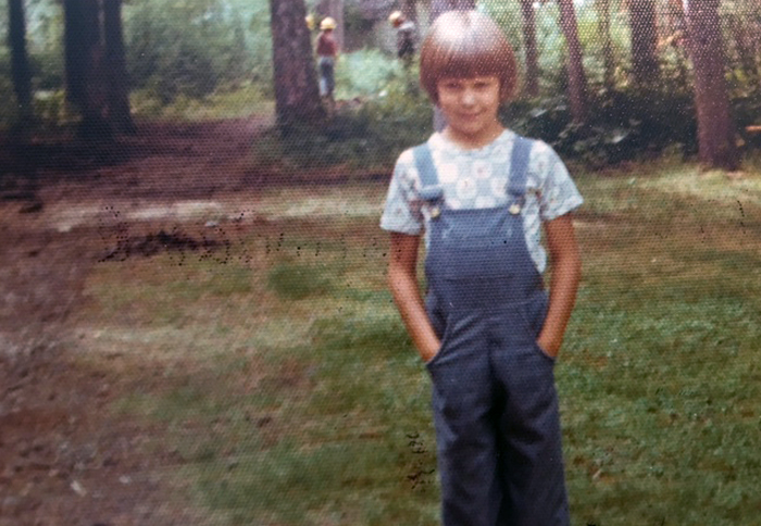 A young Susan Karlstrom in her overalls.