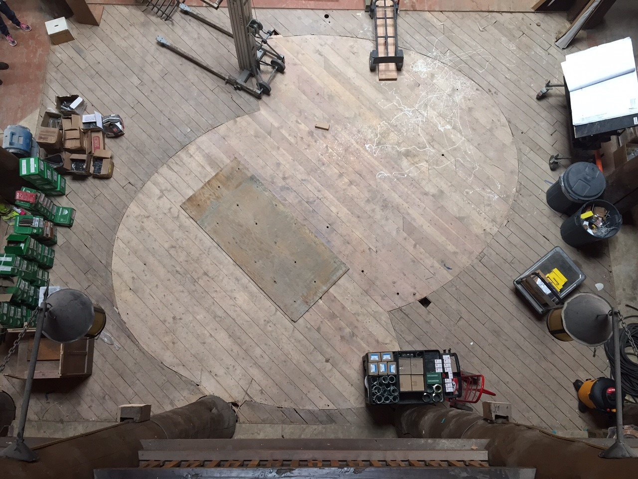 A shot from the interior balcony of the Many Glacier Hotel mezzanine, showing the original footprint of the Helical Stairs on the wooden floor.