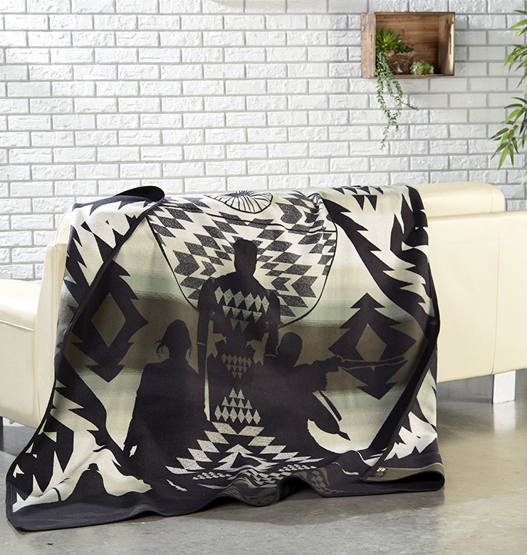 The Rogue One blanket by Pendleton, shown draped over a sofa