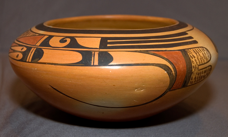 An antique Hopi clay pot glazed in tones of gold, rust, and black. Photo by Holly Chervnsik, used with permission