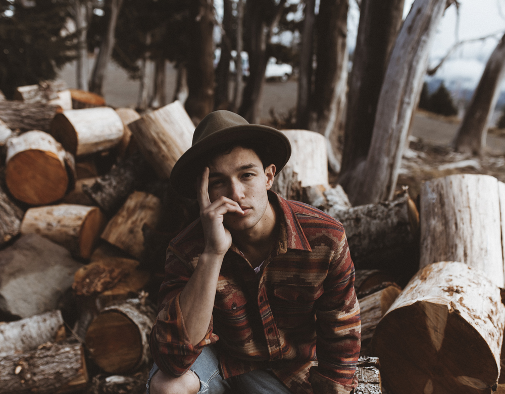 mikal_wright: sitting on a woodpile