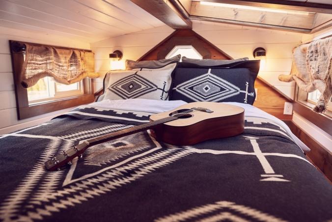 tamara_jaswal: sleeping loft with Pendleton blanket on the bed
