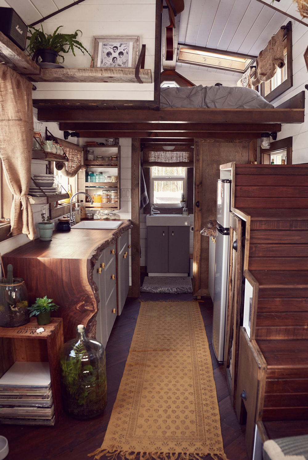 tamara_jaswal: Tiny home interior with view of kitchen and sleeping loft