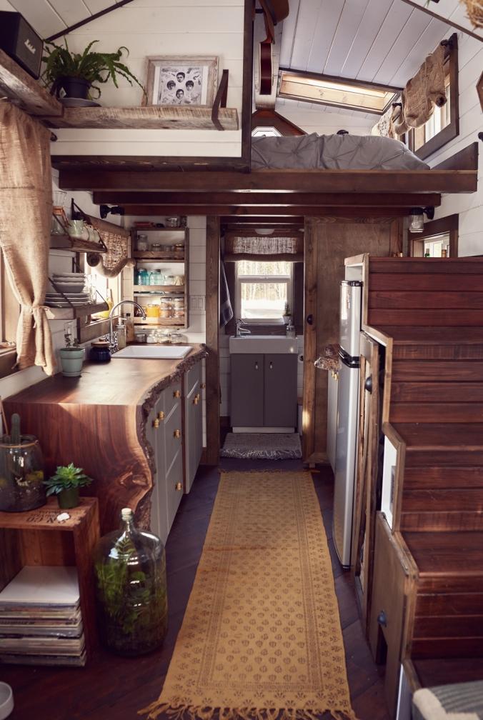 tamara_jaswal: Tiny home interior with view of kitchen and sleeping loft