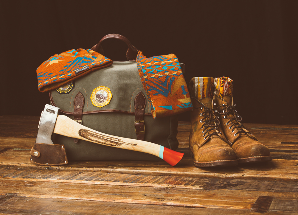 Brandon-Burk-Photography: a still live of a bag, axe, boots, scarf and beanie.