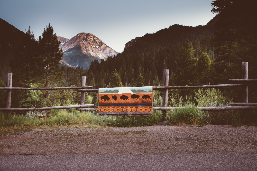 A Yellowstone national park blanket on a wooden rail fence