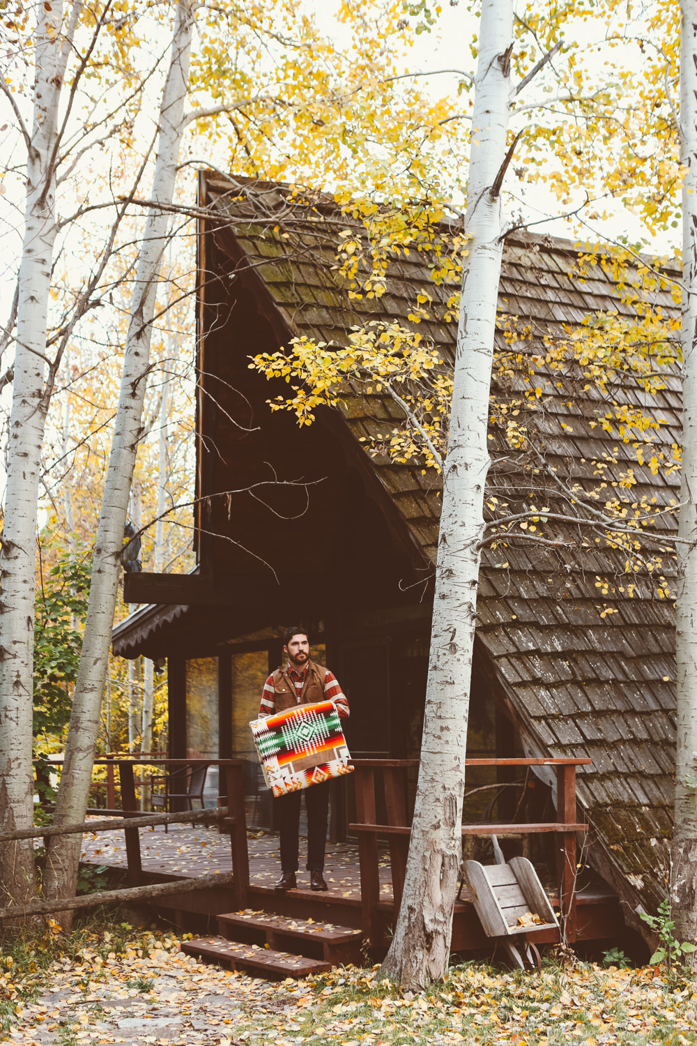 Brandon Burk by an A-frame cabin.