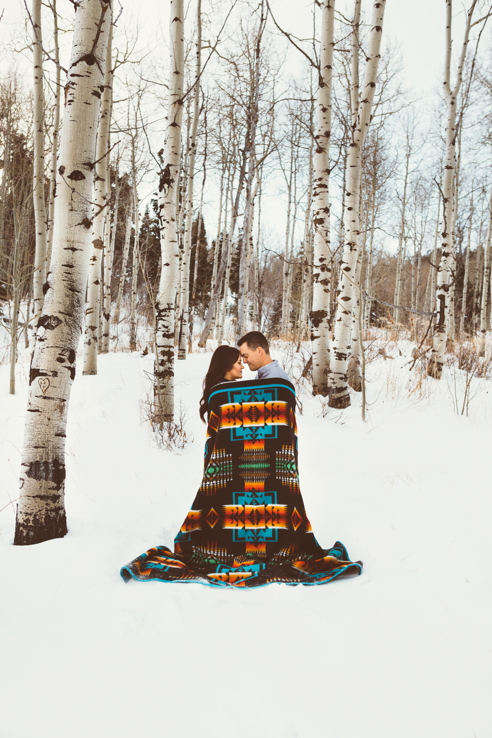 A man and woman wrapped in a Chief Josephblanket