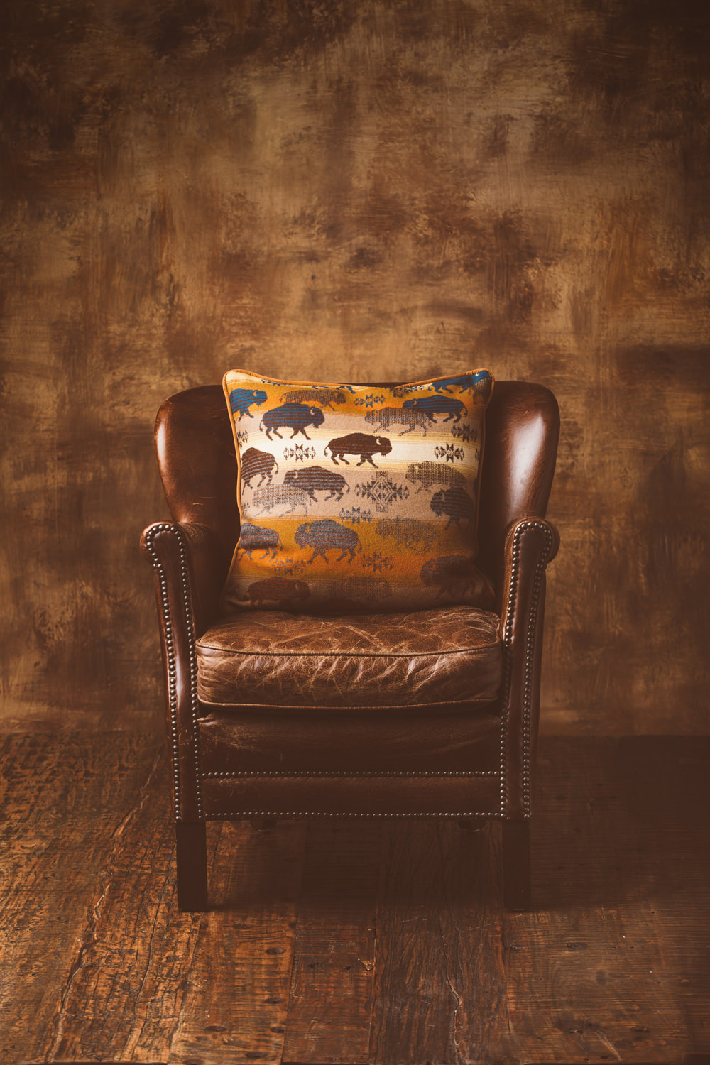 A leather chair and a buffalo wool pillow