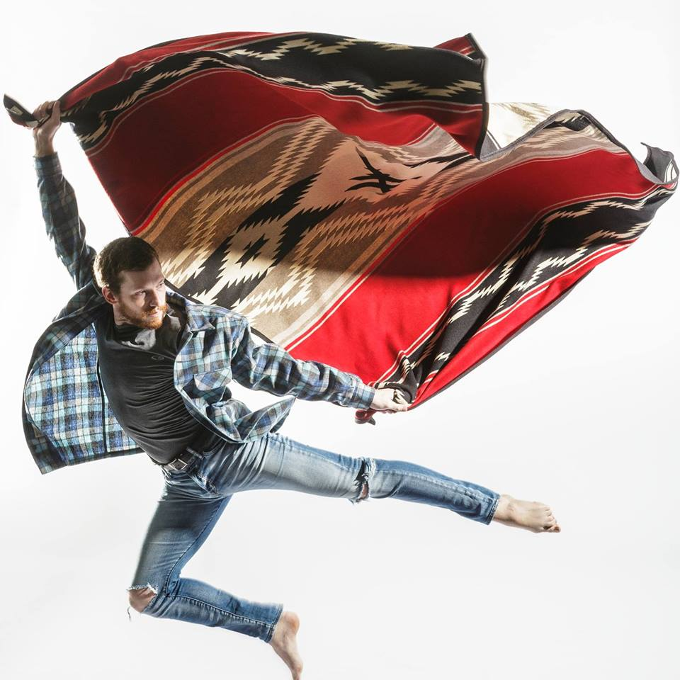 A dancer from the BodyVox company leaps in the air with a Pendleton Water blanket.