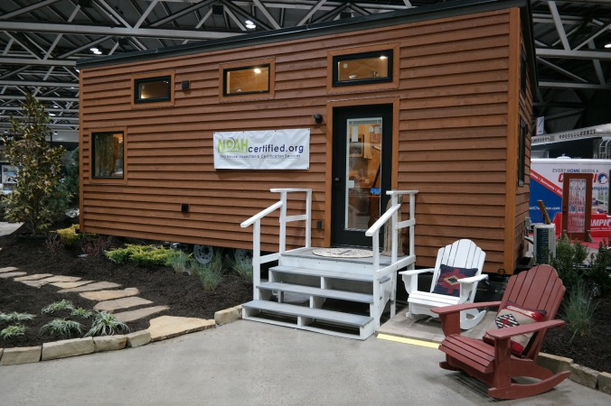 The exterior of the tiny home, which is parked inside the auditorium.