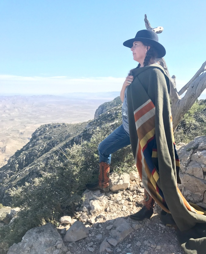 Karla Morton poses on a mountain in the Badlands with her Badlands National park blanket.