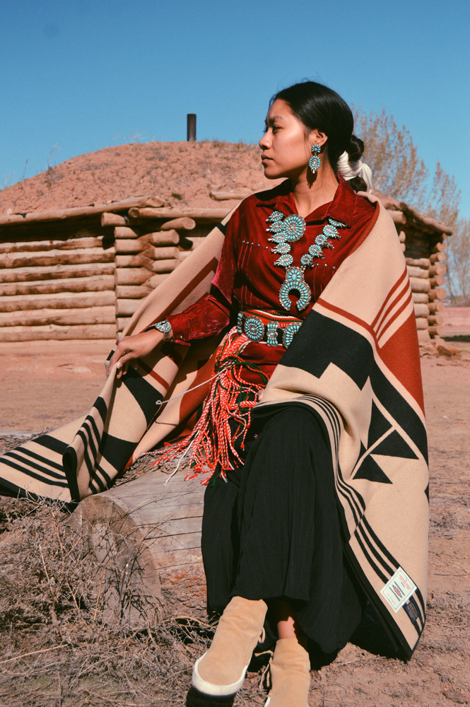 Shondina Lee styles a Gift of the Earth blanket wearing her family jewelry.