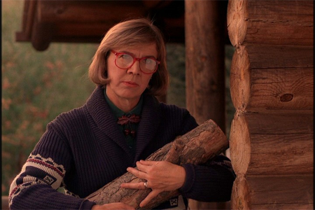 the log lady wears a vintage Pendleton sweater and carries her log