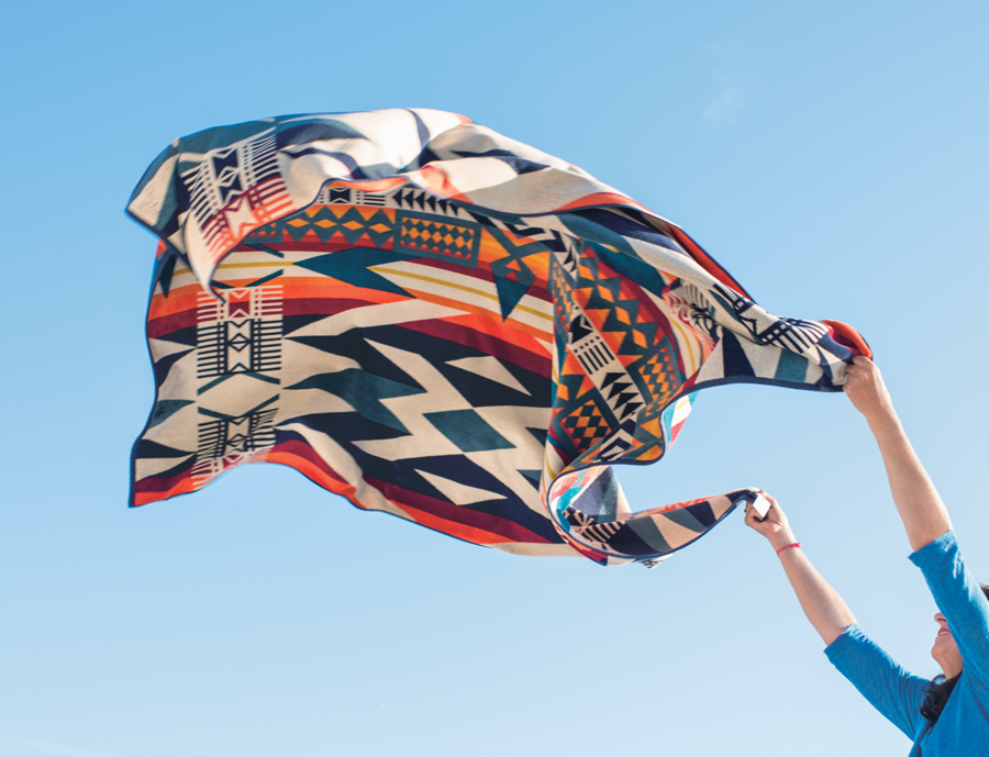 The Fire Legend towel-for-two against a blue sky.