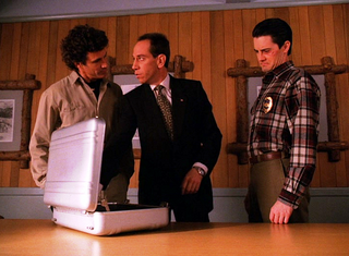 Sheriff and Agent Cooper in their offices.