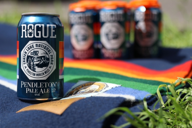 A six pack of Rogue IPA on a Crater Lake national park blanket.