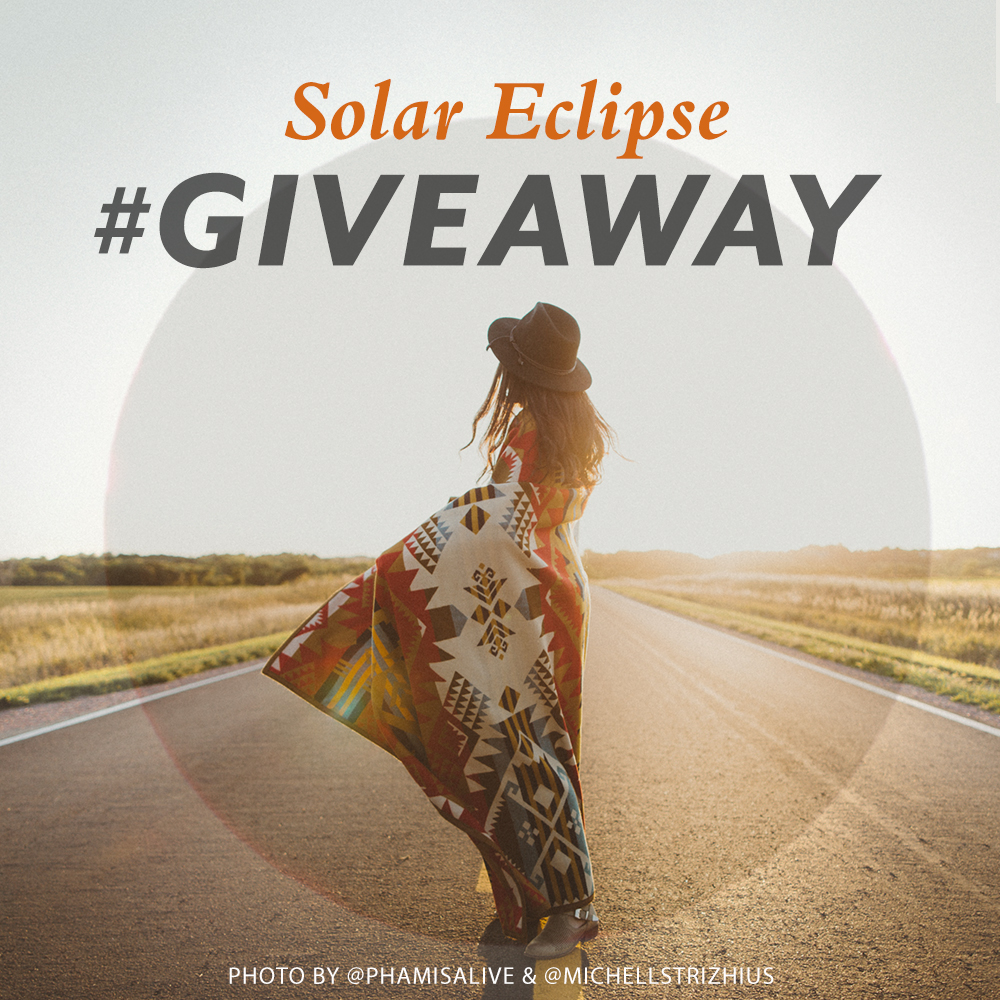 """A young woman wrapped in a Journey West blanket stares at the horizon, with the words """"Solar Eclipse Giveaway"""""""