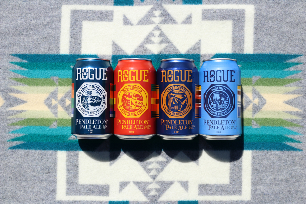 Four cans of Rogue IPA on a Pendleton Chief Joseph blanket