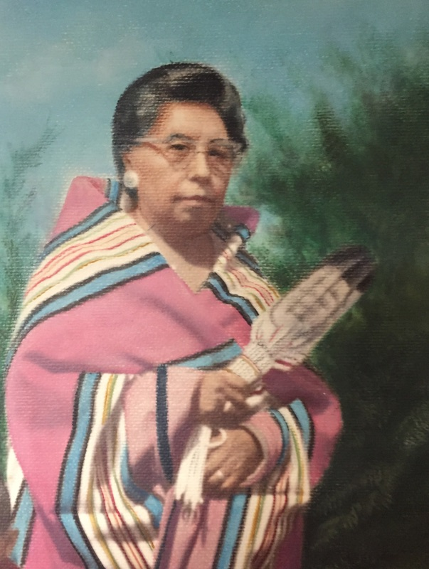 A painting of a woman wearing a striped Pendleton blanket, holding a feather fan. Artist unknown.