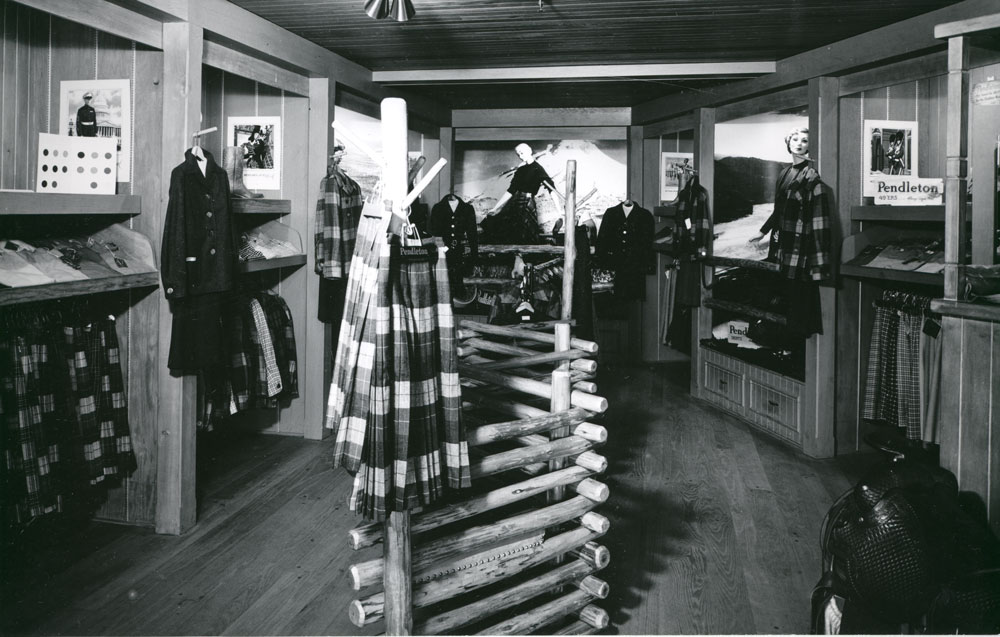 A photo from the Pendleton archives of the Pendleton store in Disneyland: Women's clothes with reversible skirts