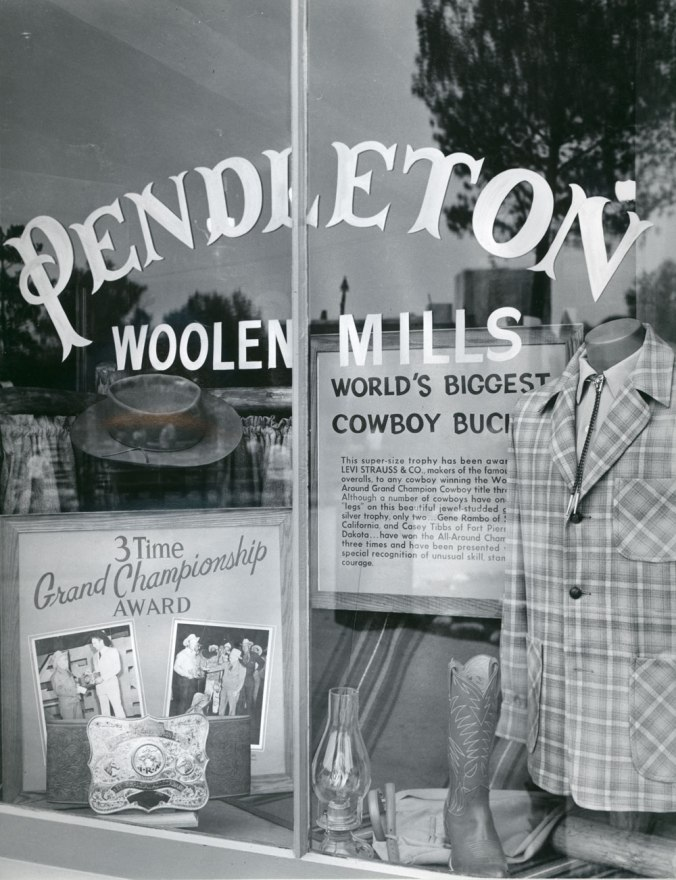 A photo from the Pendleton archives of the Pendleton store in Disneyland: Side window display featuring the Wold's Biggest Cowboy Buckle