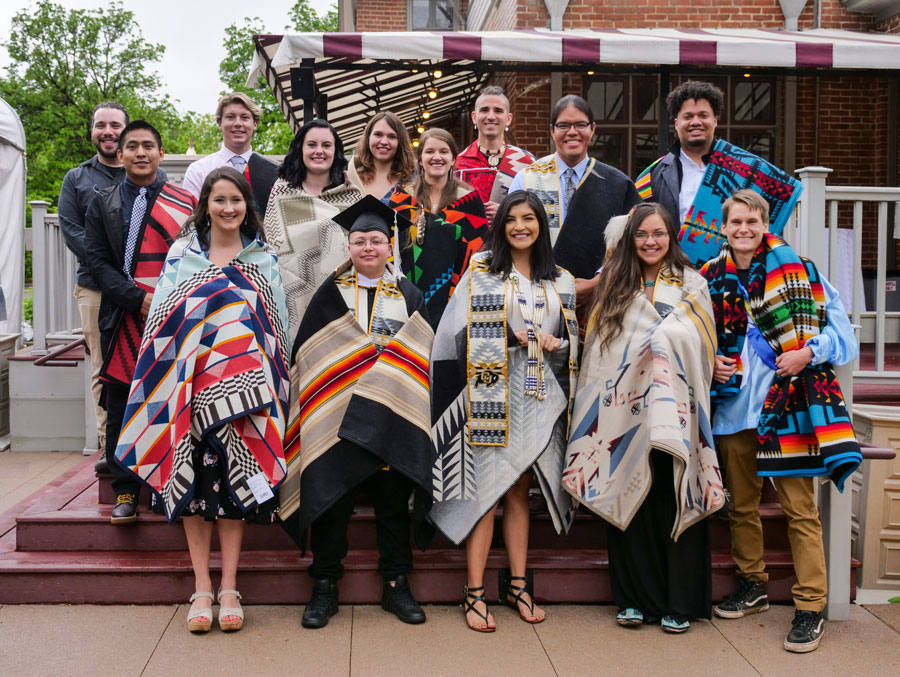 Draped in their Pendleton blankets, a class of graduating Native American students face the camera and the future.