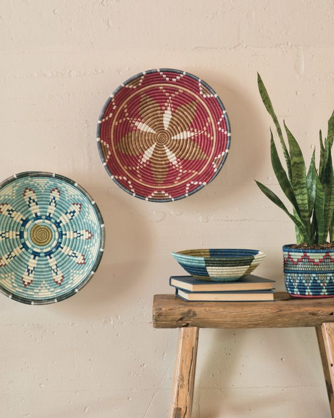 Handmade Rwandan baskets hanging on a wall and on a table