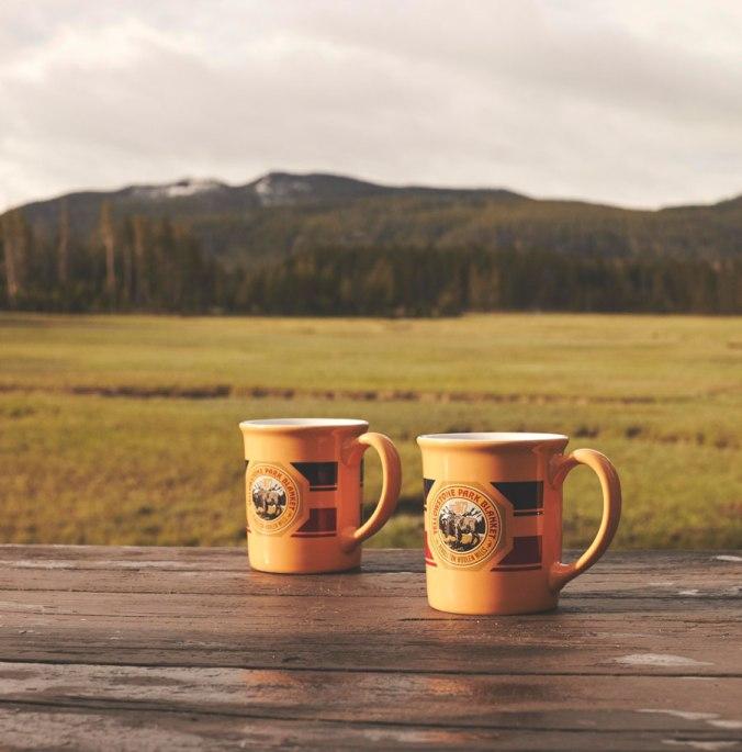 Pendleton Yellowstone Park mugs on a picnic table in Yellowstone National Park.