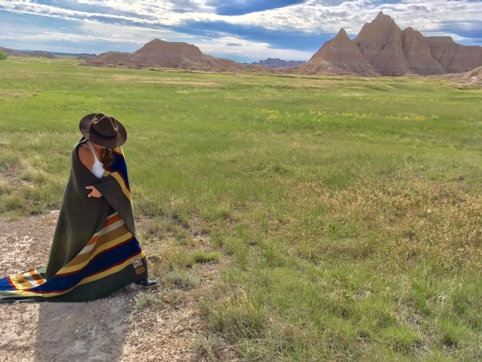the Poet Laureate of the national parks, poses in the Badlands of North Dakota with a Badlands blanket.