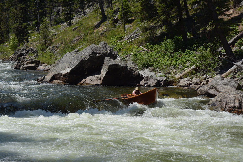 Greg Haten in his wooden boat on River of No Return in the Frank Church Wilderness of Idaho. Photo by Greg Hatten