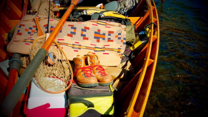 RIver running gear in Greg hatten's wooden boat, including the Painted HIlls blanket by Pendleton. Photo by Greg Hatten